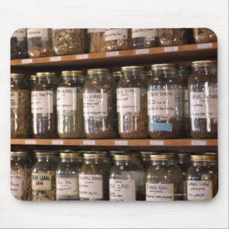 Shelves of herb jars mouse pad