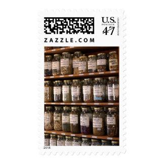 Shelves of herb jars postage