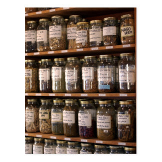 Shelves of herb jars postcard