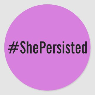#ShePersisted, black text on lavender stickers