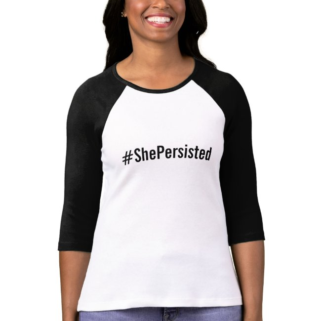 #ShePersisted, bold black text on white