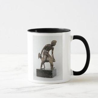 Shepherd milking a goat mug