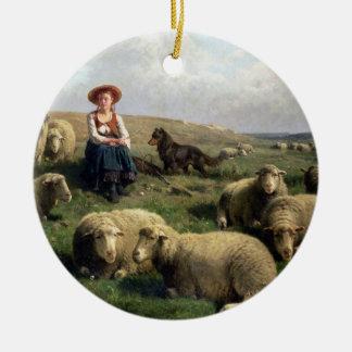 Shepherdess con las ovejas en un paisaje adorno redondo de cerámica