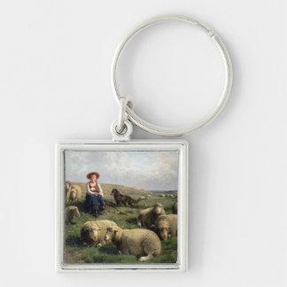 Shepherdess con las ovejas en un paisaje llavero cuadrado plateado