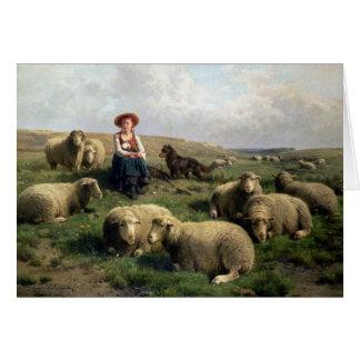 Shepherdess con las ovejas en un paisaje tarjeta de felicitación