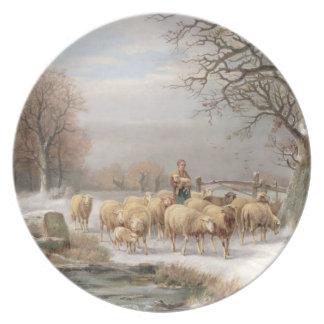 Shepherdess con su multitud en un paisaje del invi plato