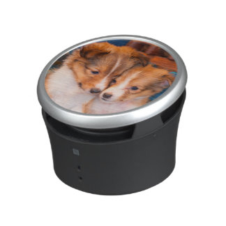 Shetland Sheepdog puppies sitting by wooden wagon Bluetooth Speaker