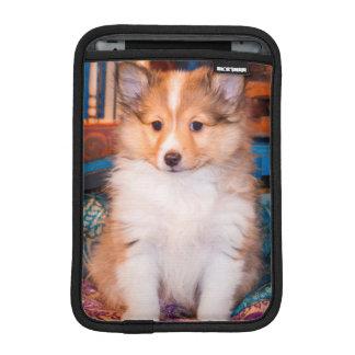 Shetland Sheepdog puppy sitting by small wagon iPad Mini Sleeve