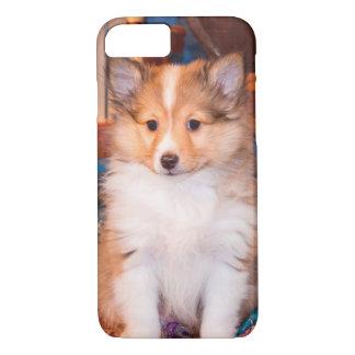 Shetland Sheepdog puppy sitting by small wagon iPhone 7 Case