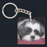 "Shih Tzu Dog Keychain<br><div class=""desc"">A Cute white and black Shih Tzu dog laying down on a rose / pink blanket. Adorable Shih Tzu Dog Breed Photograph image prints.</div>"