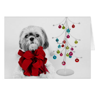 Shih Tzu dog with red bow by toy Christmas tree Card