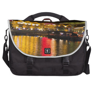 Shimmering lights and reflection in the water laptop commuter bag