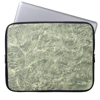 Shimmering sunlight through rippling water computer sleeve