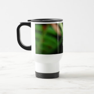 Shining red beetle in the green leaf travel mug