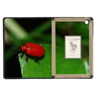 Shining red coleopter in the green leaves iPad mini retina covers