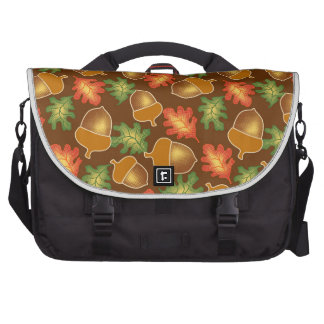 Shiny autumn atmosphere with acorns and oak leaf bags for laptop