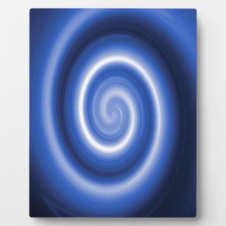 Shiny blue spiral pattern plaque