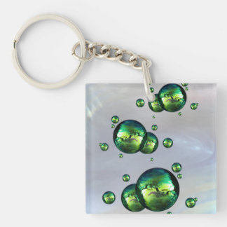 Shiny Iridescent Green Color Bubbles On White Keychain