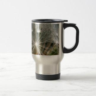 Shiny waterdrops on a white dandelion travel mug