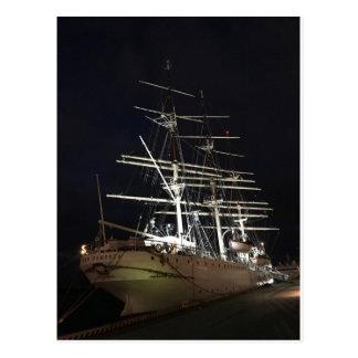 Ship at night postcard