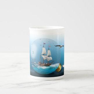 Ship in a light bulb tea cup
