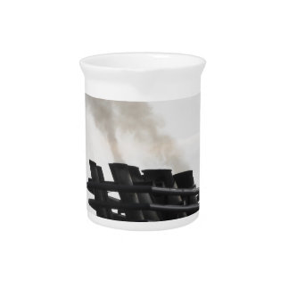 Ships funnel emitting black smoke in the sky beverage pitcher