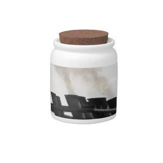 Ships funnel emitting black smoke in the sky candy jar