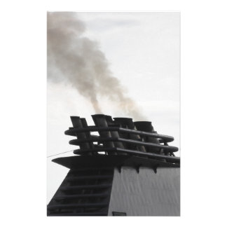 Ships funnel emitting black smoke in the sky stationery