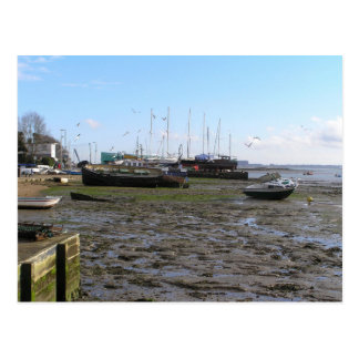shipwrecked boats at low tide postcard
