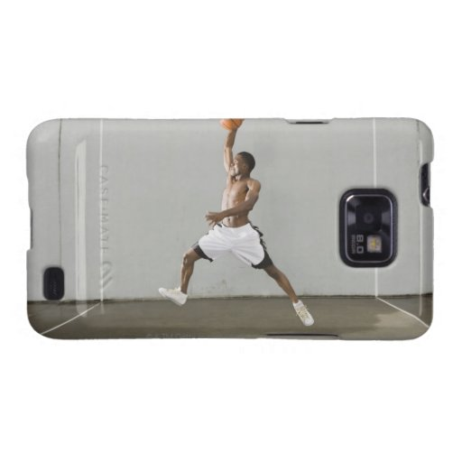 shirtless man jumping with a basketball galaxy s2 cover