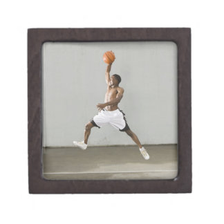 shirtless man jumping with a basketball jewelry box