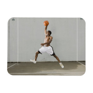 shirtless man jumping with a basketball magnet