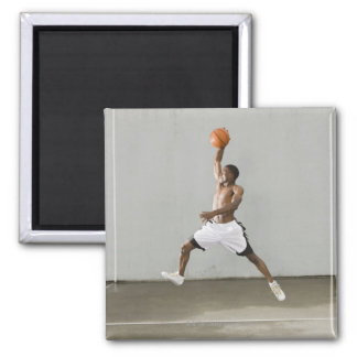 shirtless man jumping with a basketball 2 inch square magnet