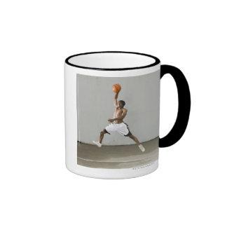 shirtless man jumping with a basketball ringer mug