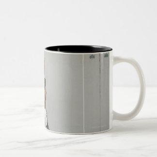 shirtless man jumping with a basketball Two-Tone coffee mug