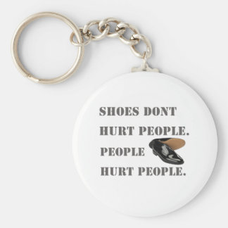 shoes dont hurt people basic round button keychain
