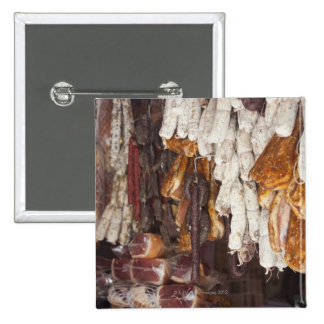 shop displaying an assortment of sausages and 2 inch square button