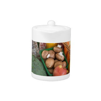 Shopping basket with foods fruits and vegetables teapot