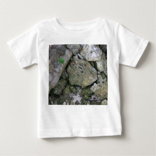 Shore rocks, jagged, with small green shoot baby T-Shirt