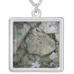 Shore rocks, jagged, with small green shoot custom jewelry