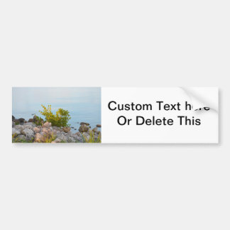 shoreline with rocks and plants of river bumper sticker