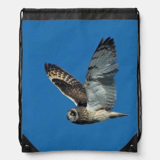 Short-eared Owl ( Asio flammeus) in flight Drawstring Bag