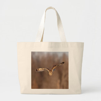Short-eared owl diving towards the ground large tote bag