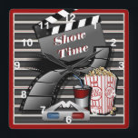 """Show Time Movie Theater Square Wall Clock<br><div class=""""desc"""">Showtime Movie Cinema Clock. Makes a great to add to your theater room, family room or recreational room or business. Click on the CUSTOMIZE IT button to change or add your text. SEE MORE DESIGNS AT: http://www.zazzle.com/designsbydonnasiggy* original design by Donna Siegrist &#169; 2014. If you have any questions about this...</div>"""
