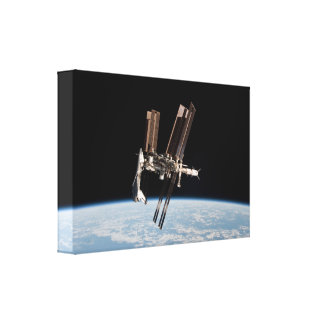 Shuttle Docks With The International Space Station Canvas Print