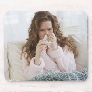 Sick woman on couch mouse pad