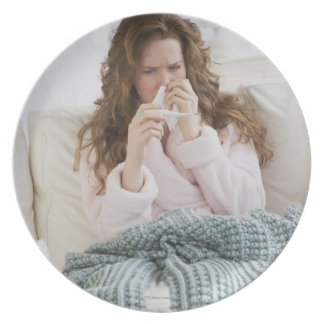 Sick woman on couch plate