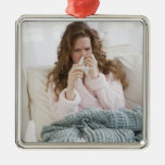 Sick woman on couch square metal christmas ornament