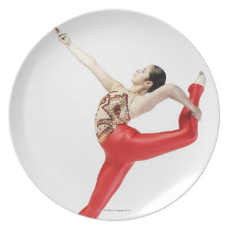 Side profile of a female gymnast practicing dinner plate