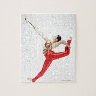 Side profile of a female gymnast practicing puzzle